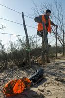 hunter climbing fence