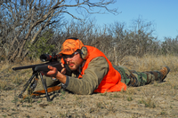 Shooter using a bipod support, prone
