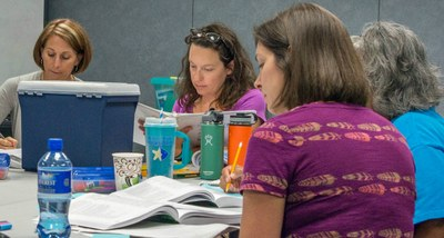 Educators working in books at a table