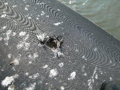 Intentional cut in the geotextile breakwater
