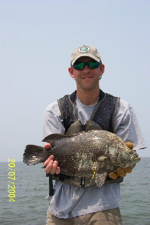 Person Holding Tripletail