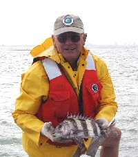 biologist with sheepshead in all weather 
