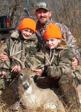 Richard, Charlie and Sarah Gainey with Sarah's deer.
