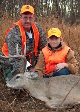 Tommy and Taylor Faught with Taylor's deer.