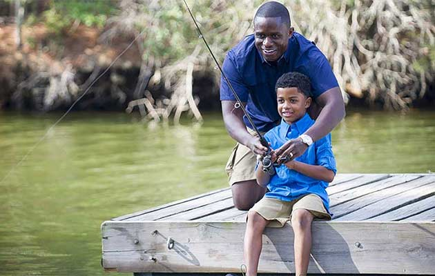 Father and son fishing on Lake Bastrop