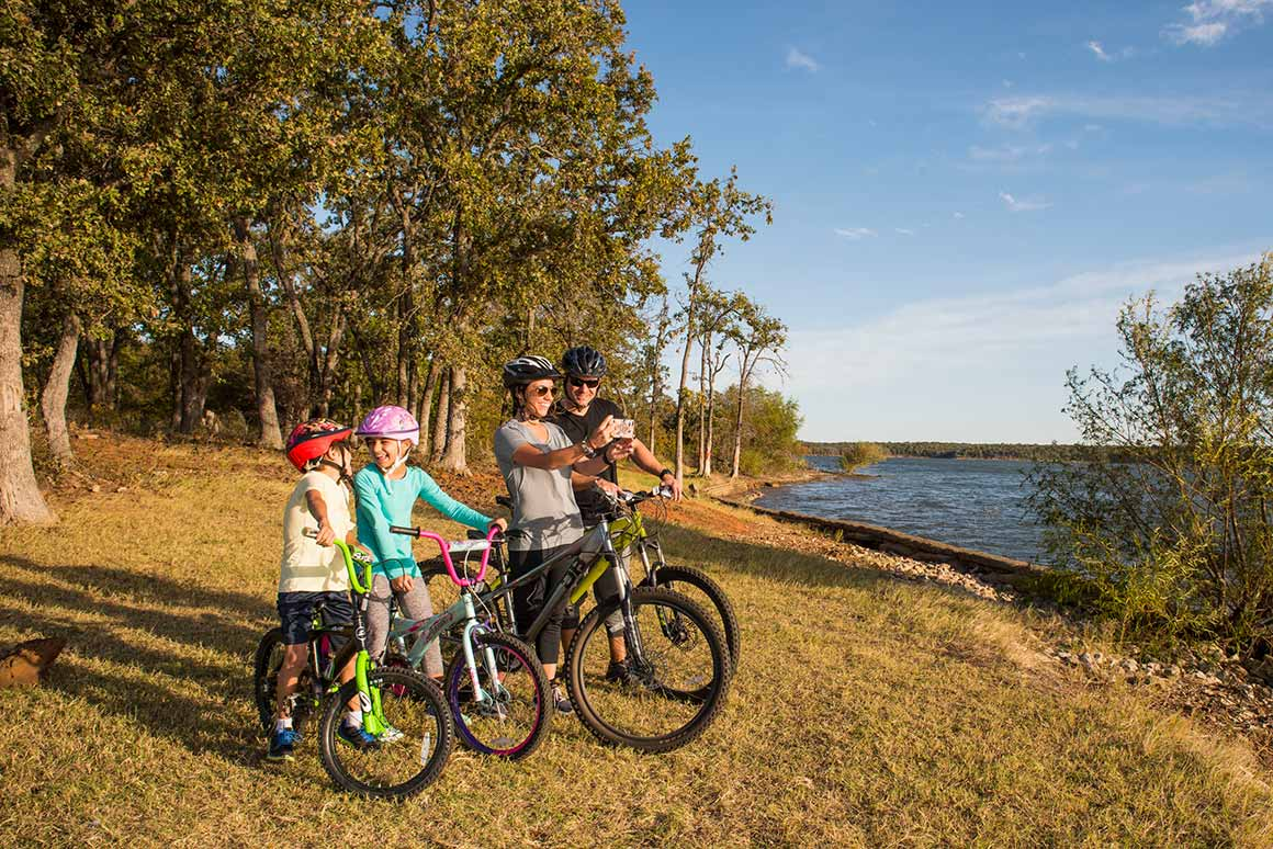 Family biking in a Ray Roberts Lake State Park