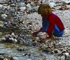 Girl Squatting by Stream at Lost Maples State Natural Area West of San Antonio