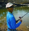 Urban Teenager Tries Fishing at Mary Jo Peckham Park in Katy Near Houston
