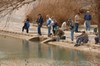 People Fishing at a TPWD Trout Stocking