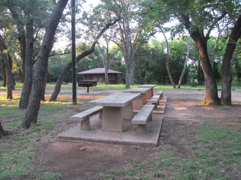 The shelters are scattered around this picnic area, which has a large waist-high grill.