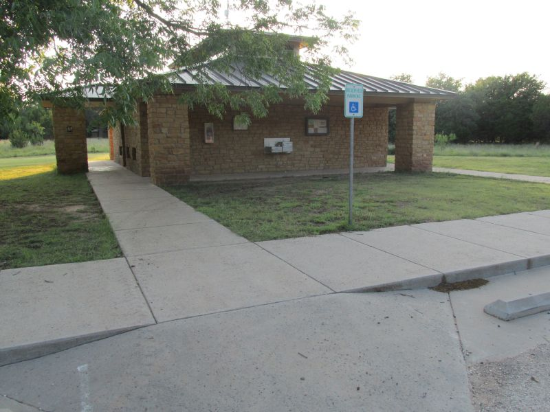 Restrooms with showers across from the shelter area.