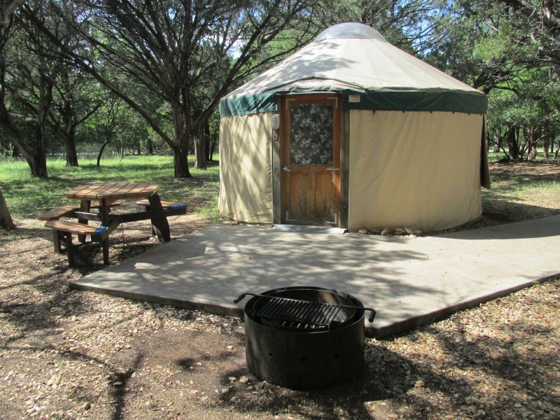 Yurt #2 has a concrete sidewalk and patio.
