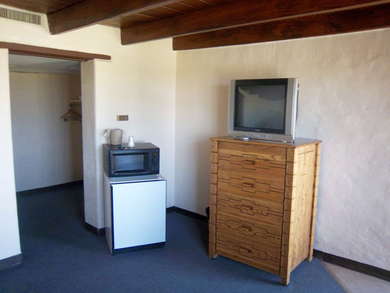 There is a microwave oven, mini-refrigerator, and a TV.