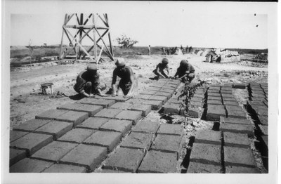 CCC workers laying adobe bricks out to dry.
