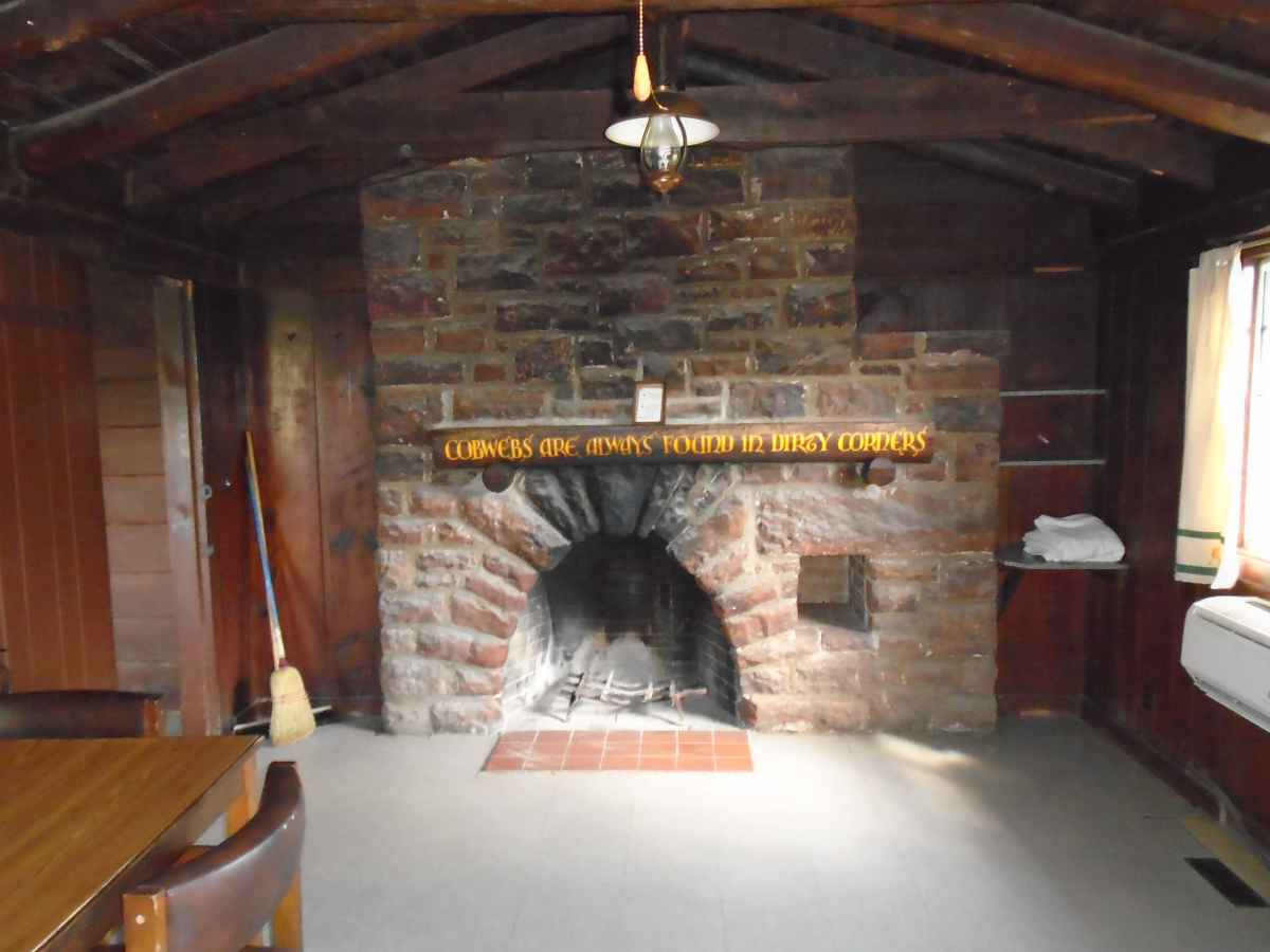 Cabin 11 has a fireplace in the living area.