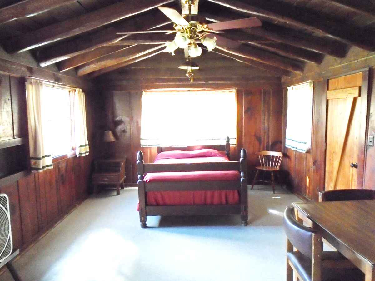 Cabin 11 has a double bed in the living area.