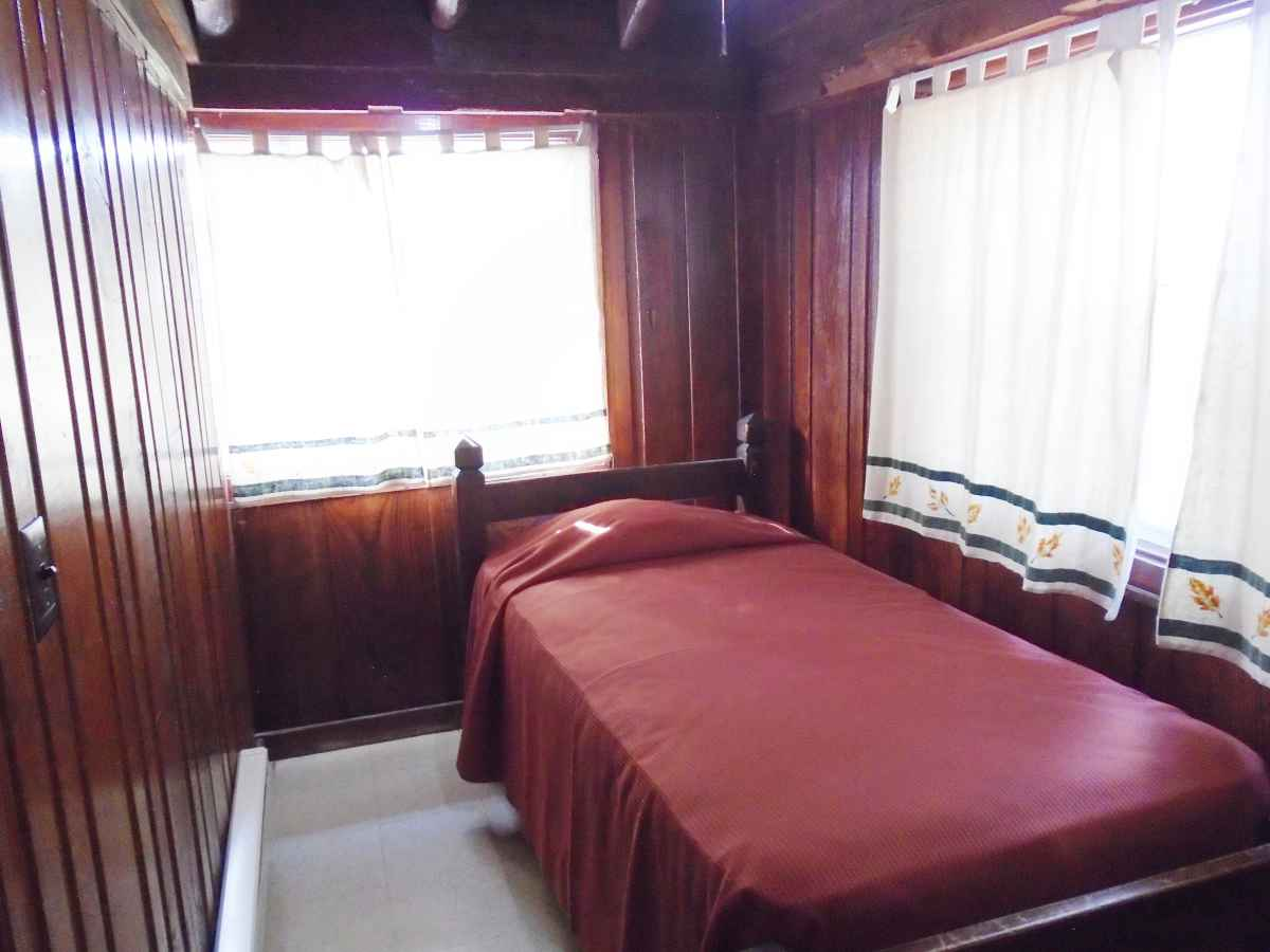 The bedroom in Cabin 11 has a single bed.