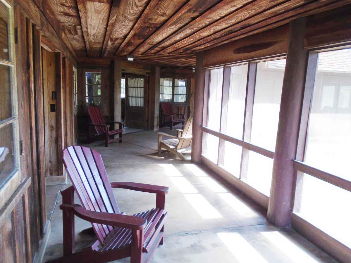 Cabin 12 has a huge, back screened-in porch.