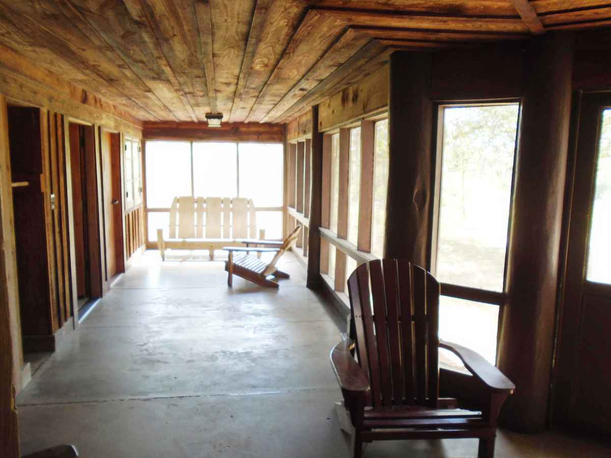 Another view of the huge, back screened-in porch of Cabin 12.