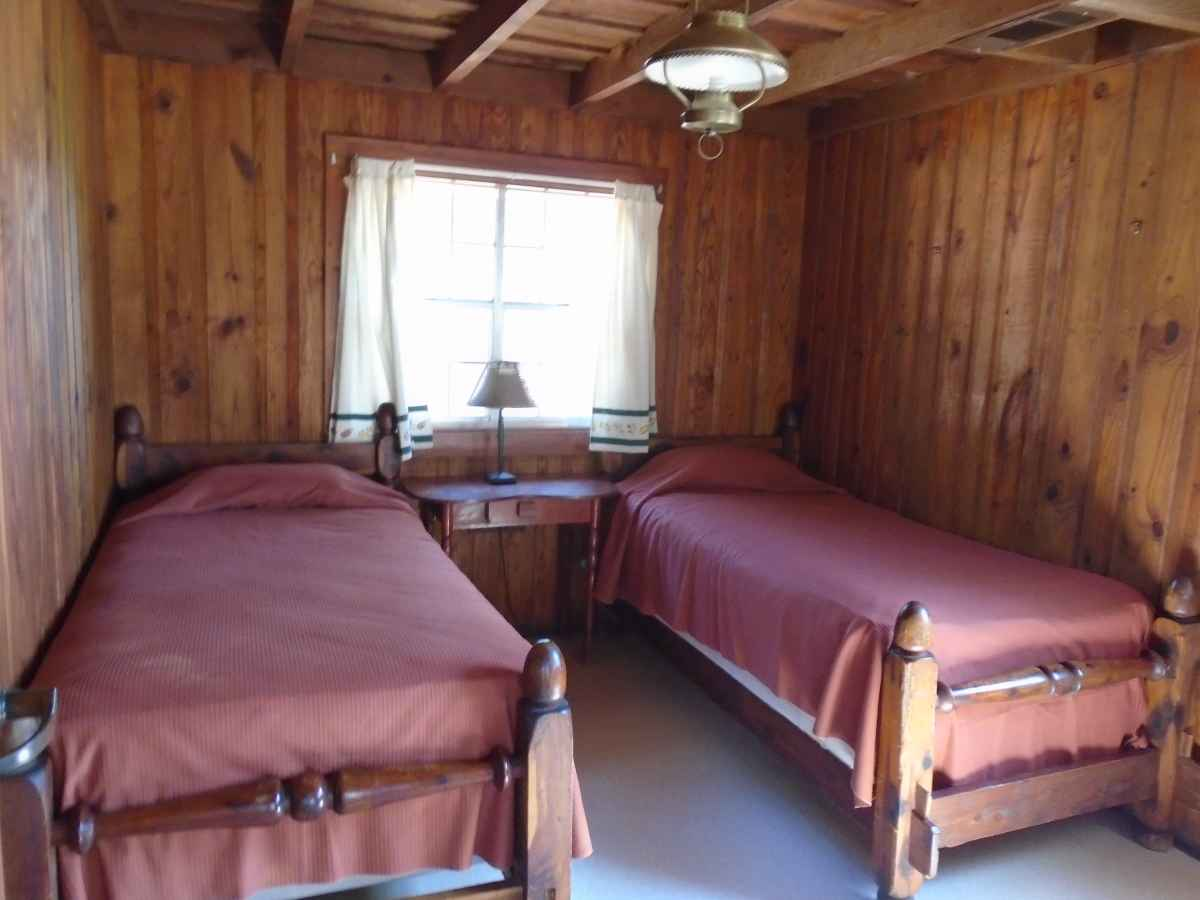 Bedrooms 3 and 4 both have two single beds.