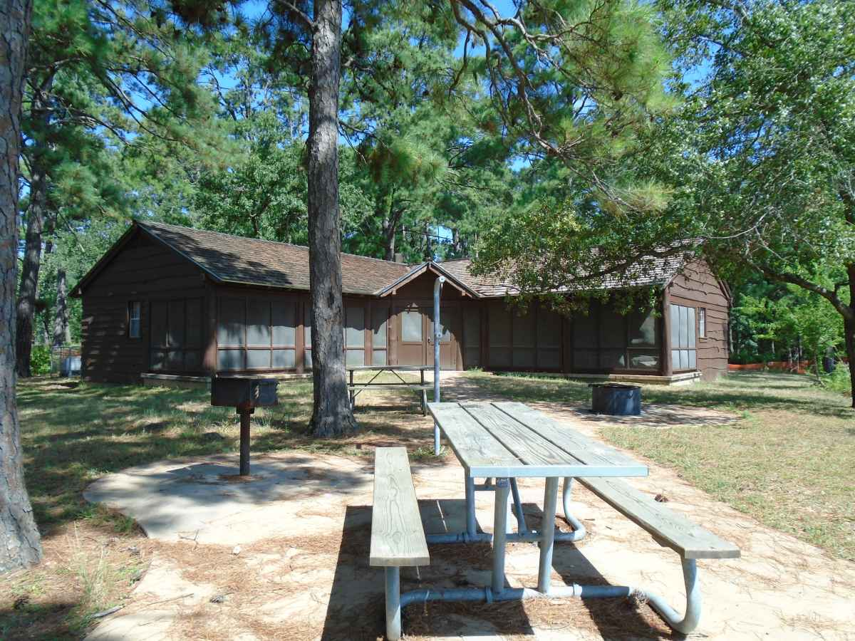 Cabin 12 also has two picnic tables, a fire ring with a grill, an upright grill and a lantern post in the back.  Photo taken in July 2015.