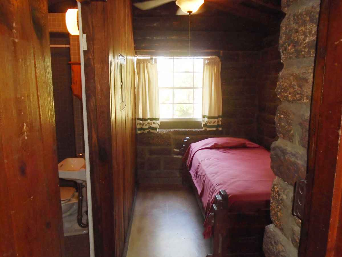 The second bedroom of Cabin 4 has a single bed.