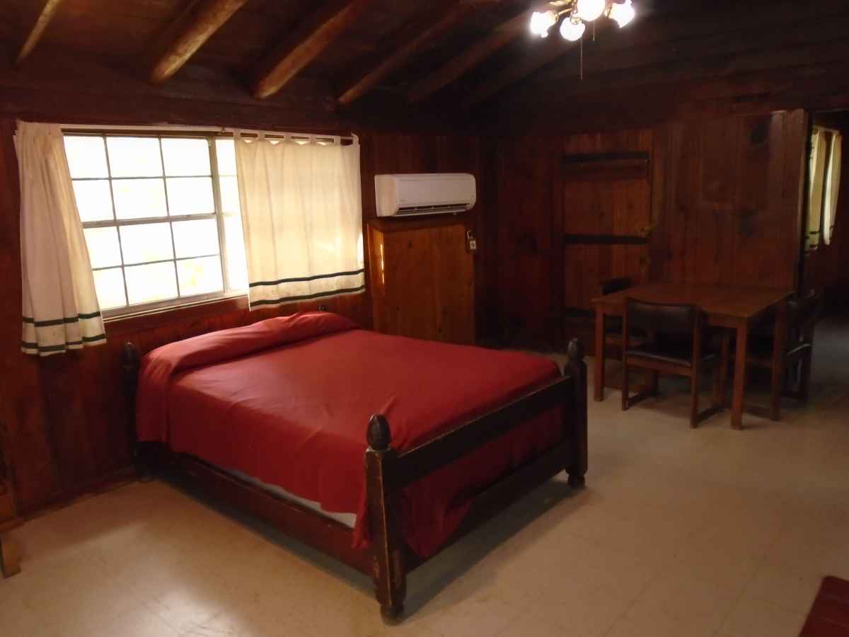The living area of Cabin 7 has one double bed.