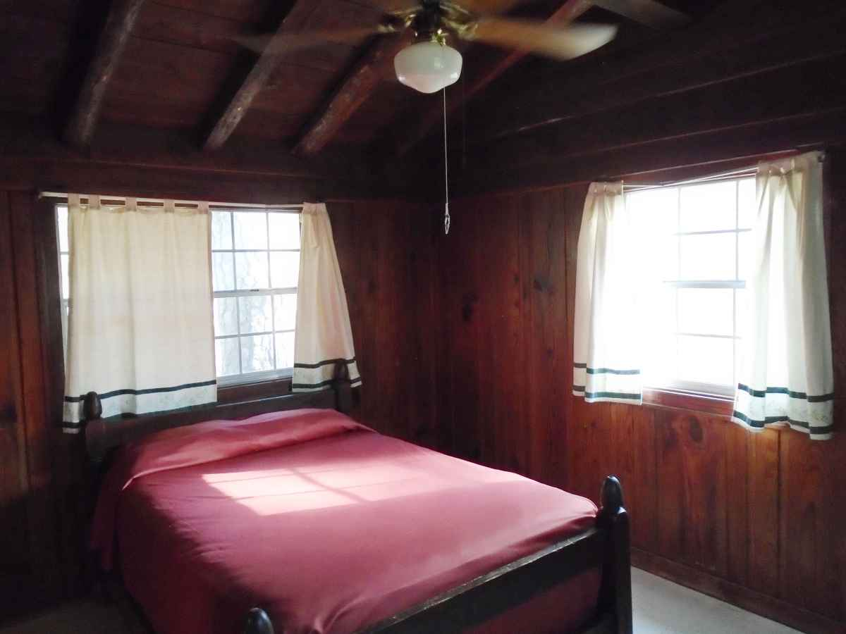 Bedroom 1 of Cabin 7 has one double bed.