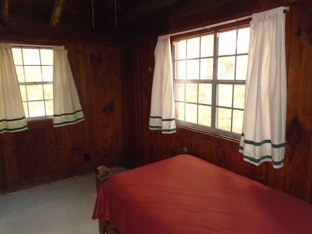 Bedroom 2 of Cabin 7 has a single bed.