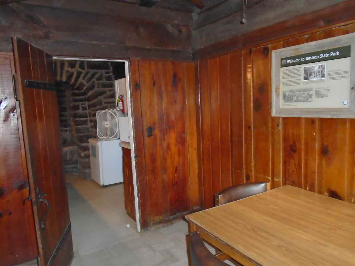 A view of part of the dining area and kitchen in Cabin 9.