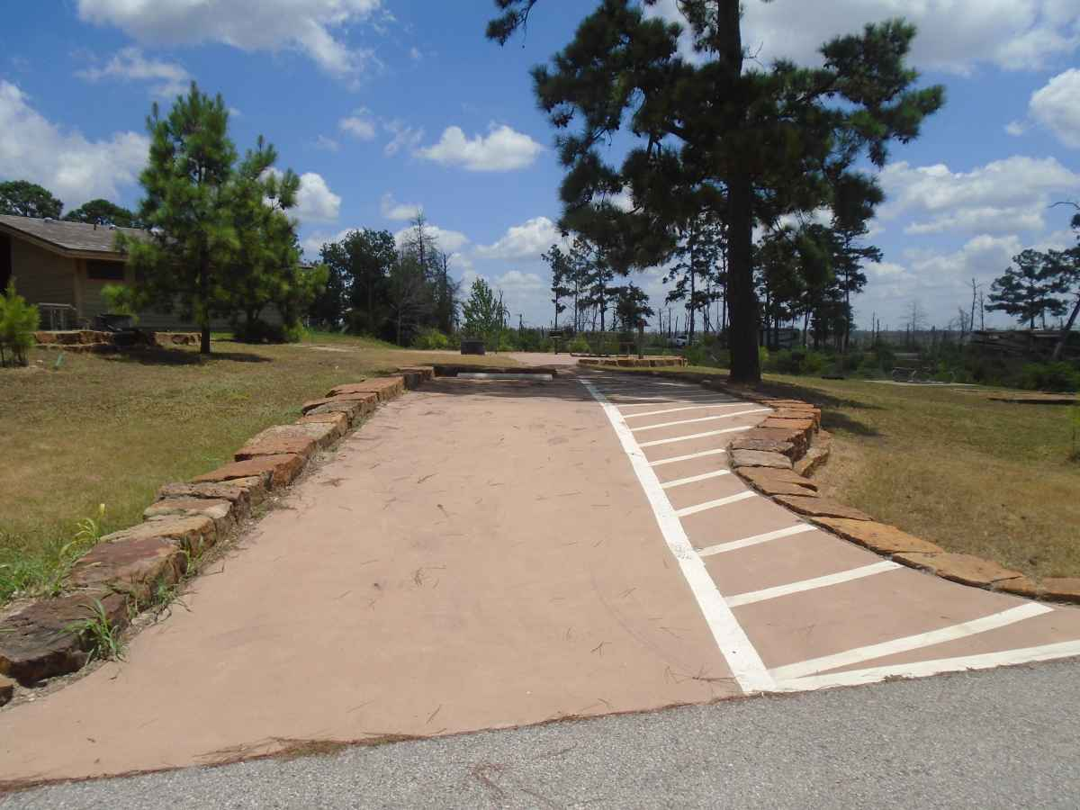 Accessible Campsite #28 is close to the bathrooms and has a raised fire ring, upright grill, lantern post, picnic table and paved walkways designed for use with a wheelchair.