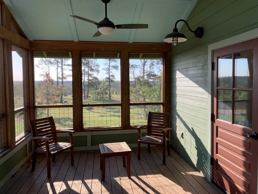 Inside Dorm 1 screened porch.
