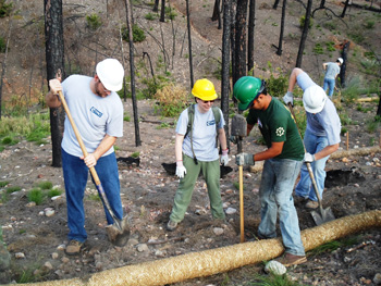 Volunteers working on a trail