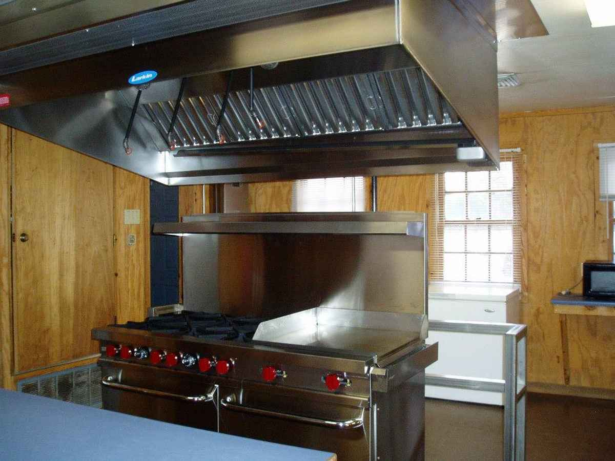 Looking at the commercial stove in the Dining Hall kitchen.