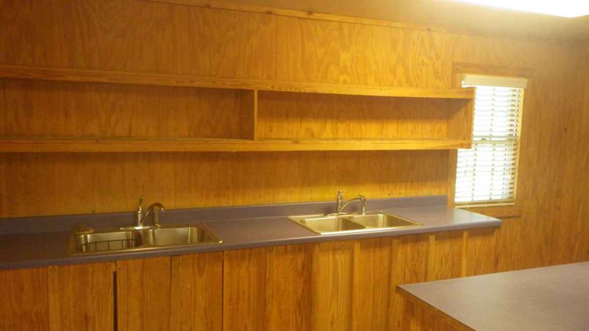 two sinks and plenty of shelf and prep. space are in the kitchen.