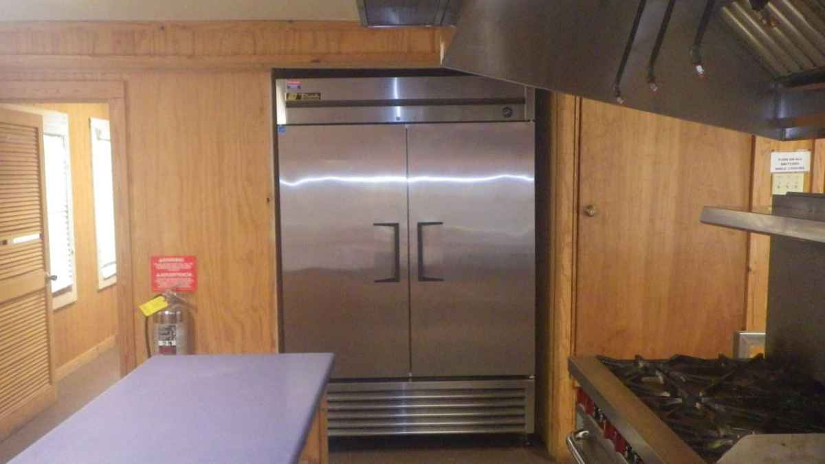 Looking at the commercial refrigerator in the Dining Hall kitchen.