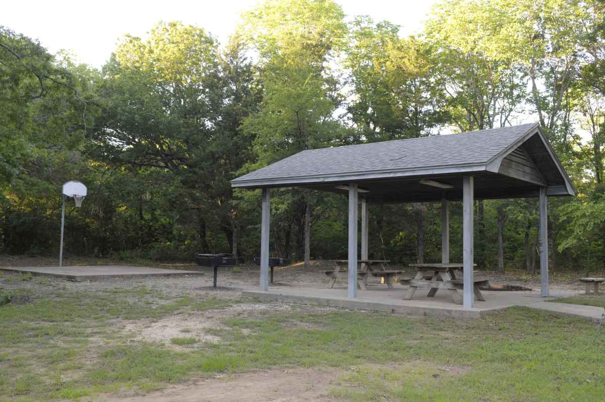 This pavilion and basketball court come with this facility.