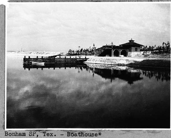 Black and white historic photo of boathouse