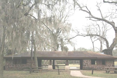 stone pavilion surrounded by trees draped in Spanish moss