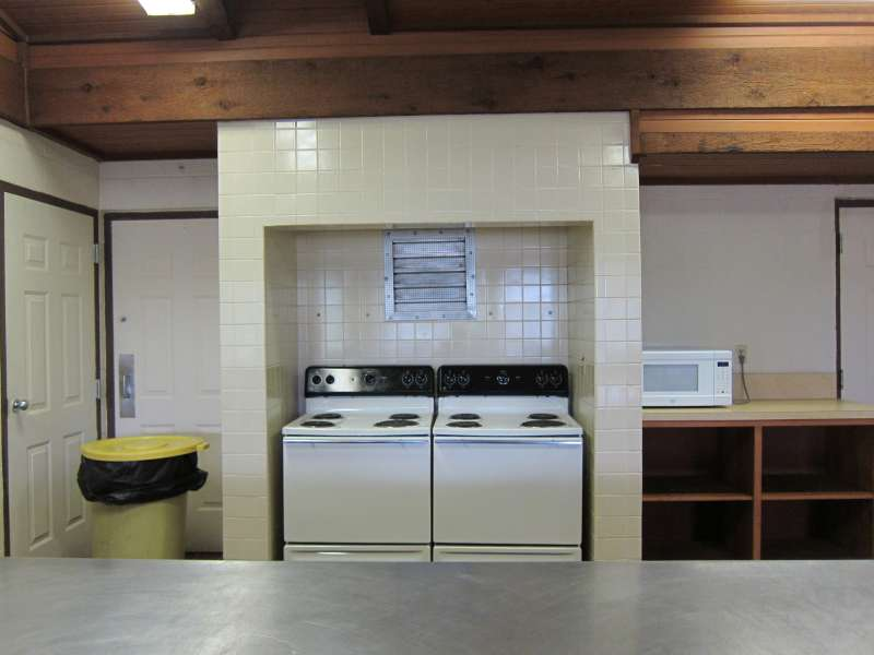 Two oven/stoves and a microwave oven are in the kitchen area.