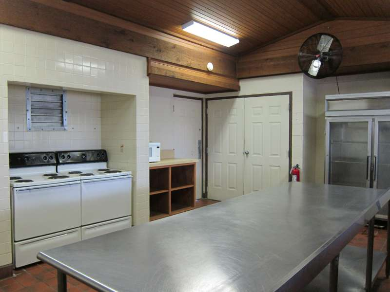 Lots of shelves, prep area, and a commercial refrigerator.