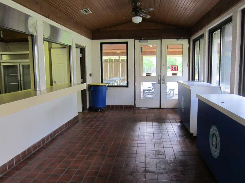 This hallway connects the gymnasium/stage to the kitchen/serving area, and the outside covered dining area.