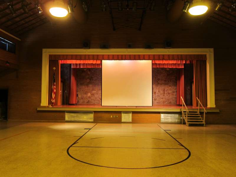 The Stage inside the Gymnasium with the projection screen open.