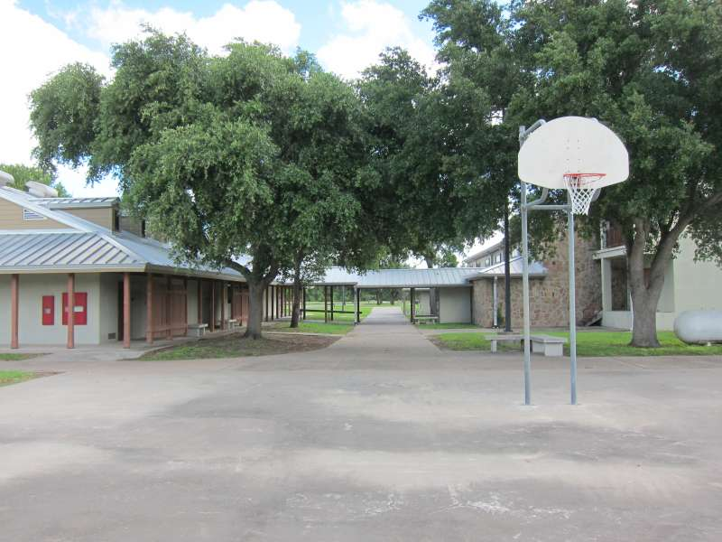 This outdoor basketball court is in the Sports Complex Area behind the Gymnasium/stage and near the Dining Hall and Interpretive Center.