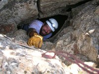 Caver coming out of tight space