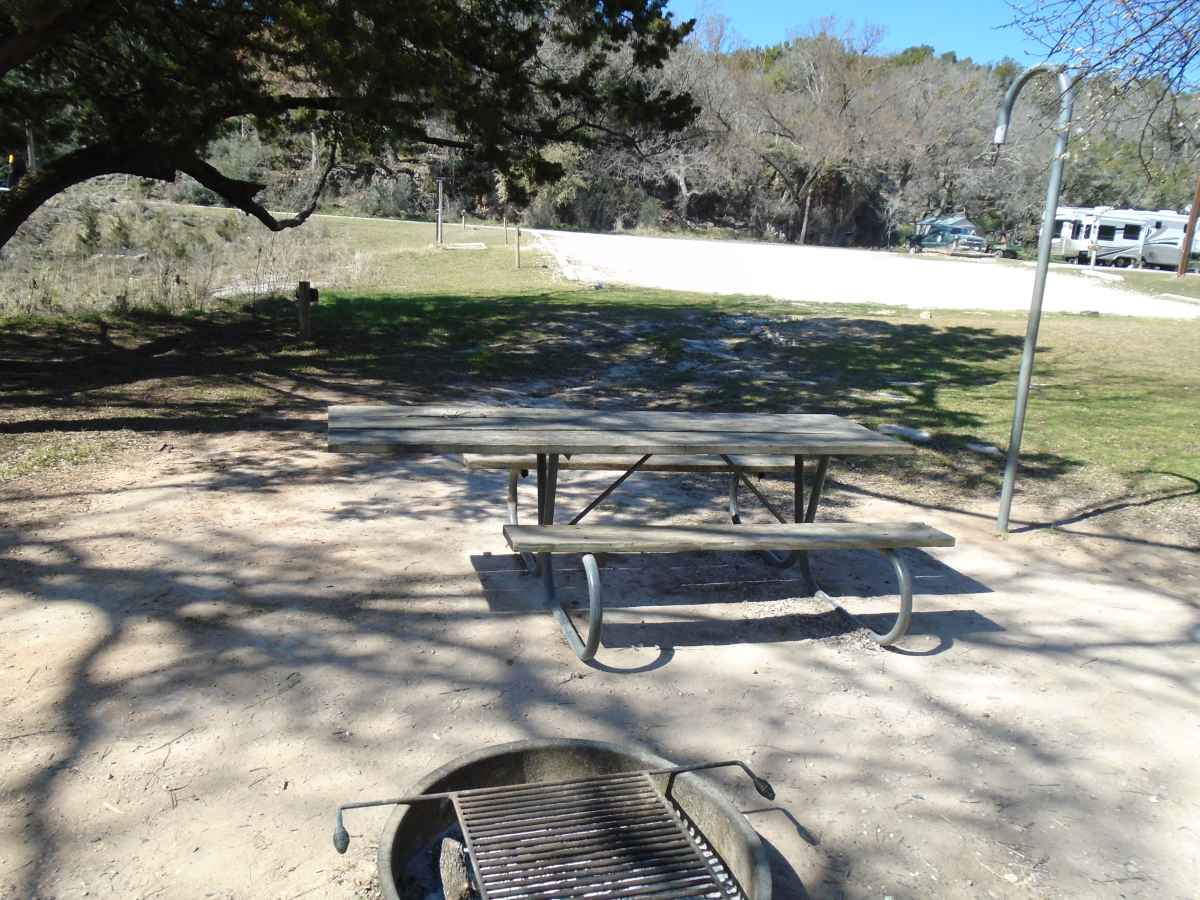 The short trail to Campsite 19 is unpaved but the site has a large cement slab and a wheelchair friendly picnic table.