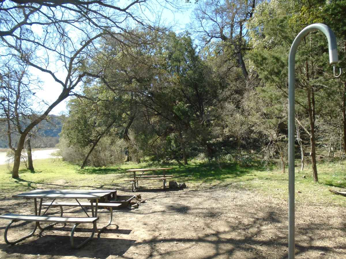 The Canyon Group Campsite has 2 picnic tables, a large fire ring with a grill and a lantern post.