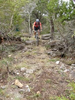 Mountain biker on a trail.