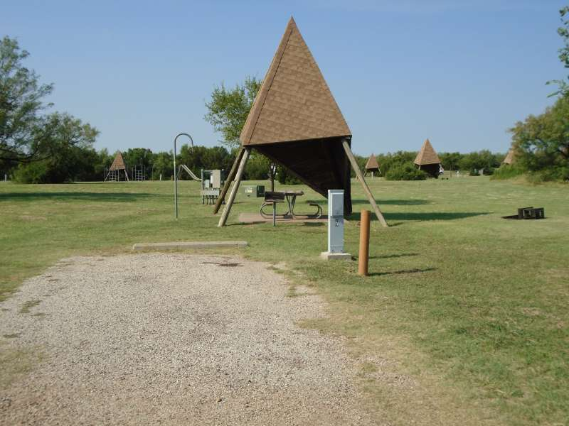 Campsite #7, with the playground in the background, in the Comanche Camping Area.