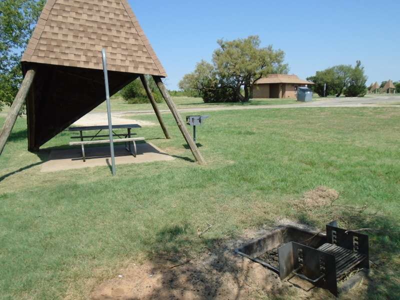 Campsite #12, with the bathrooms in the background, in the Comanche Camping Area.
